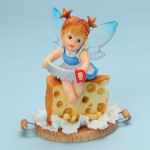 Girl Fairy Cutting Holes in Cheese